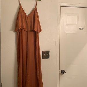 Burnt orange jumpsuit with riffle top.
